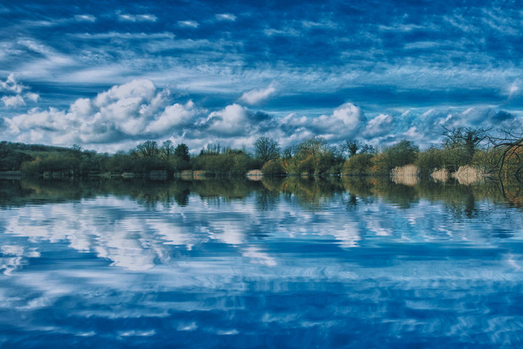 Blue reflections Water Reflection Cloud - Sky Sky Lake Beauty In Nature Scenics - Nature Tranquility Tranquil Scene Waterfront Tree Day Nature Plant No People Blue Outdoors Non-urban Scene Idyllic