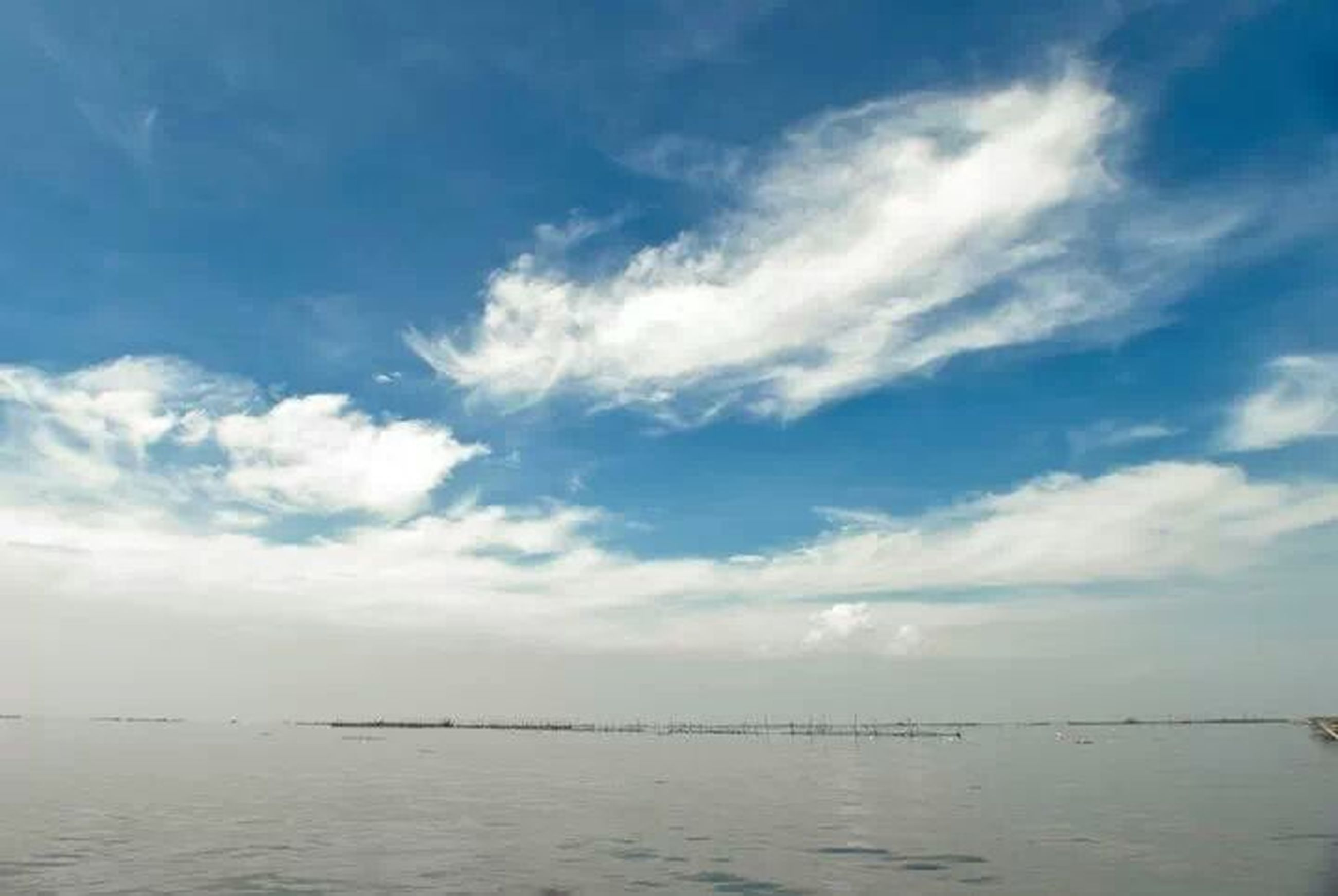 water, sky, tranquility, sea, tranquil scene, waterfront, scenics, beauty in nature, cloud - sky, horizon over water, nature, idyllic, cloud, blue, cloudy, rippled, day, outdoors, seascape, calm