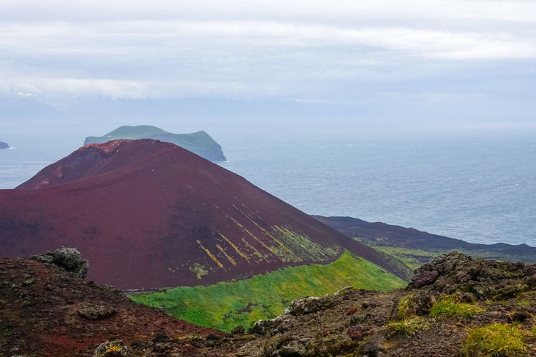 Summer Iceland Vestmannaeyjar Red Rocks  Red Mountain Green And Red Contrasting Colors Contrast In Nature Calm Windy Remote Places Remote Place Remote Location Island Heimaey Mountain Fog Landscape Cloud - Sky Volcanic Landscape Volcanic Rock Volcano Volcanic Crater Geology