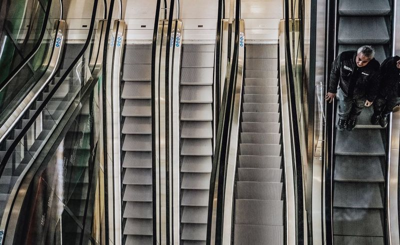 Markethall Steps And Staircases Steps Staircase Real People Railing Men Built Structure Subway Station Lifestyles Women Architecture Adults Only People Adult Modern Technology Day City Indoors