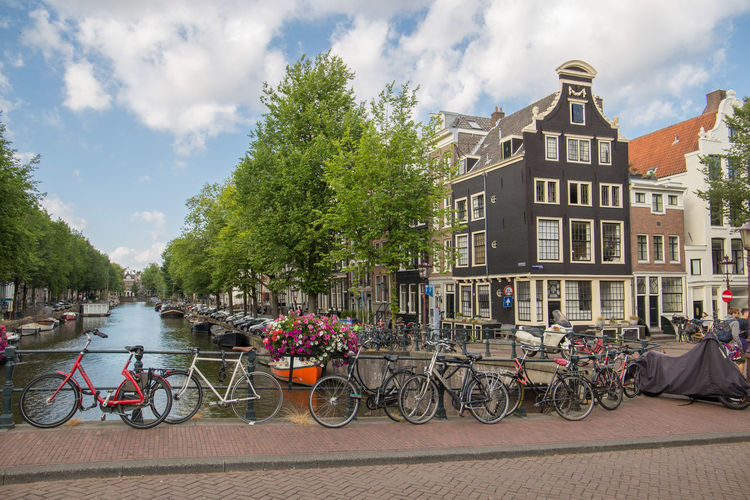 Amsterdam Netherlands Architecture Bicycle Bikes Bridge Building Building Exterior Built Structure Canal Canal House City Cloud - Sky Day Dutch Houses Group Of People Herengracht Holland Incidental People Land Vehicle Mode Of Transportation Nature Outdoors Plant Real People River Sky Tourism Transportation Tree Water