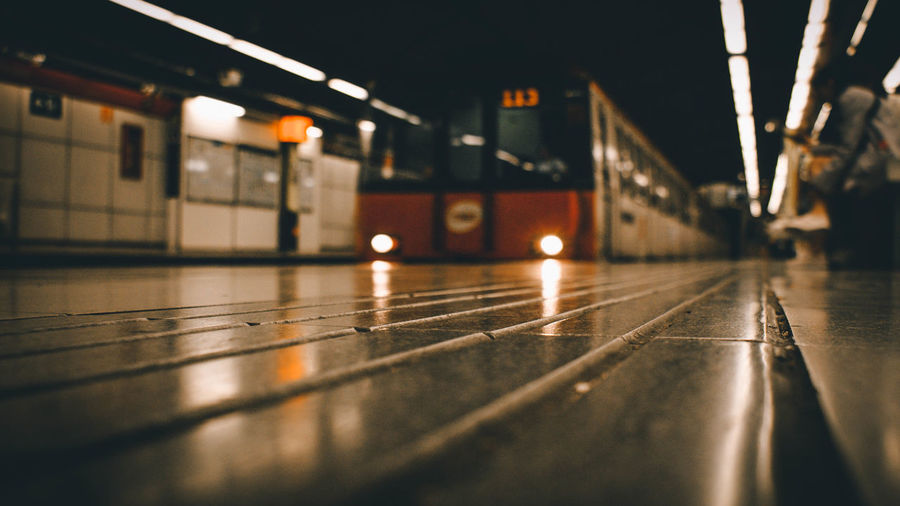 Illuminated Selective Focus Architecture Surface Level Public Transportation Indoors  Flooring Rail Transportation Transportation Reflection Built Structure Railroad Station Night Lighting Equipment No People Railroad Station Platform Mode Of Transportation Travel