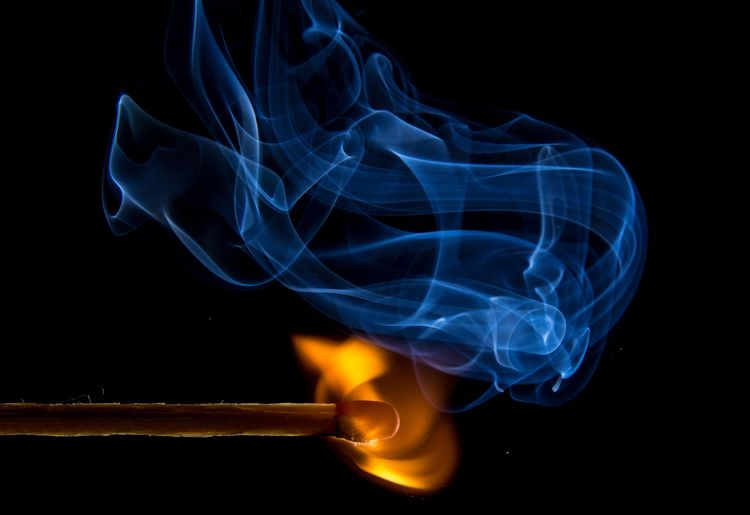 Close-up of burning matchstick
