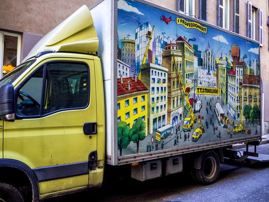 ~7日間イタリアの旅~ 通りの停まっていたトラックの絵がPOP City Cityscape Italia Mirano Architecture Building Exterior Car Colorful Italy Land Vehicle Mode Of Transport No People Outdoors Street Transportation Yellow