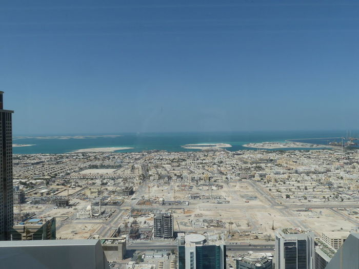 View of Dubai Coast with The World (left horizon) & Artificial Islands viewed from Jumeirah Hotel, Dubai, United Arab Emirates 2019 Dubai UAE 2019 Sea Water City Cityscape Horizon The World Blue Skysunlight High Angle View No People Residential District Horizon Over Water Lansscape Artificial Islands Islands Composition Outdoor Photography Tourist Destination Tourism Beach