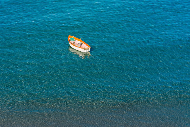 High angle view of boat anchored on sea