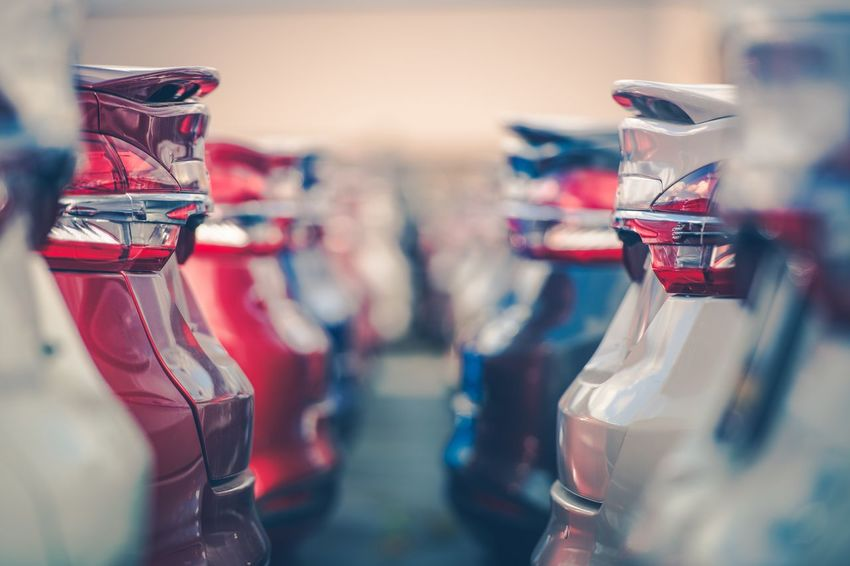 Cars For Sale. Automotive Industry. Cars Dealership Parking Lot. Rows of Brand New Vehicles Awaiting New Owners. Car Lights Cars Car Crash Close-up Day Dealer Dealership Destination Drive Driver License Financing In Stockholm In A Row Indoors  Multi Colored No People Red Selective Focus Vehicles