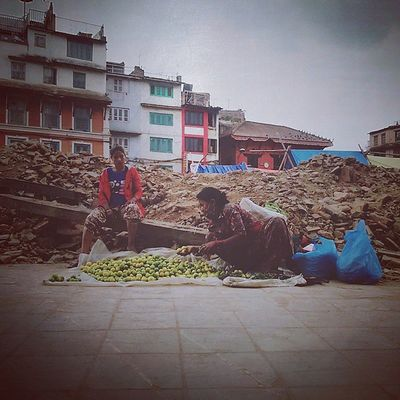 Life continues in Basantapur. Lemon vendors stalls their shop nearby the rubbles of Kasthamandap. We suffered a huge loss of life in the Kasthmandap. Rebuildingnepal Nepalearthquake2015 Nepal Basantapur Local Localshop
