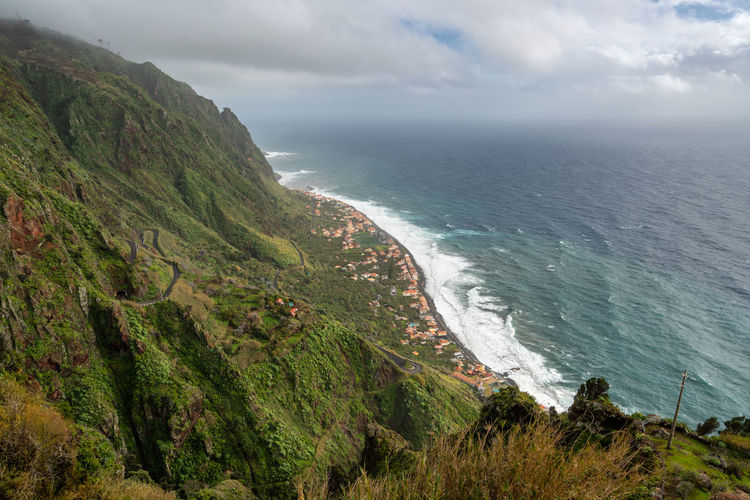 Aerial view of Paul do Mar from Faja da Ovelha in Madeira Architecture City Madeira Nature Panorama Panoramic Paul Do Mar Portugal Portuguese Road Travel Trees Aerial Aerial View Beach Fajã Da Ovelha Island Landscape Mountains Ocean Outdoors Sea Seascape Village Waves