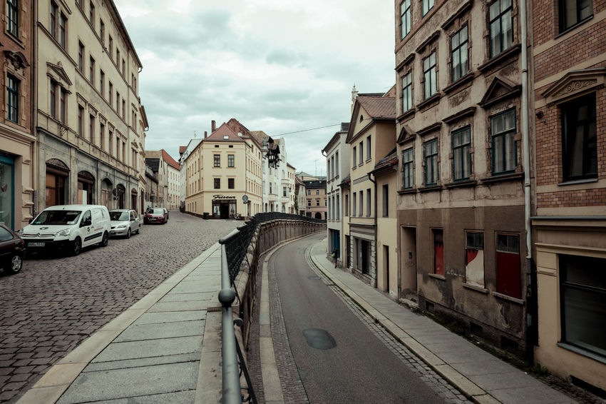 The up and down at Altenburg City City Street Road Architecture Building Exterior Built Structure Car City Day Daylight Down Land Vehicle Mode Of Transport No People Outdoors Road Sky Street Street Photography Streetphotography Town Transportation Up Way The Week On EyeEm