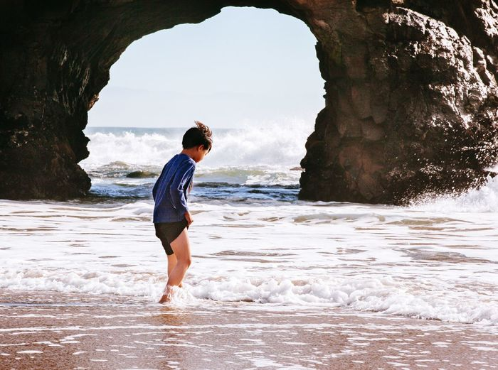 Boy Wading In Sea