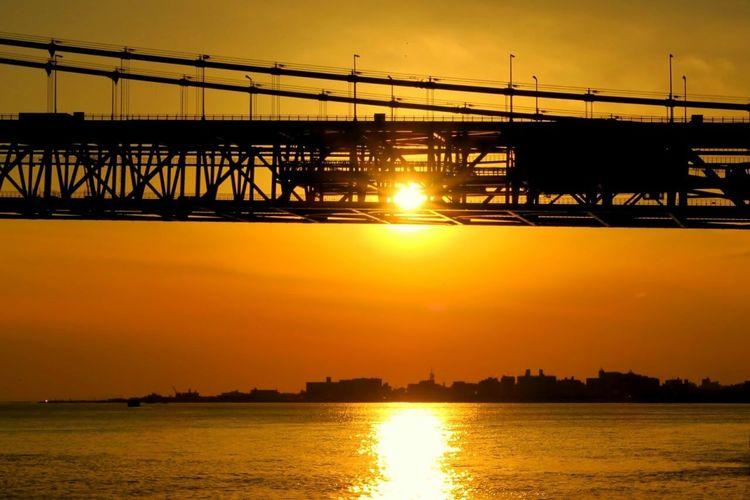 Bridge Over Calm Lake At Sunset