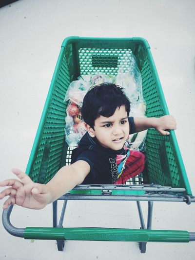 Boys Cart Casual Clothing Childhood Cute Day Enjoyment Full Length Fun Grocery Grocery Shopping Innocence Leisure Activity Lifestyles Person Playful Playground Playing Portrait Shopping