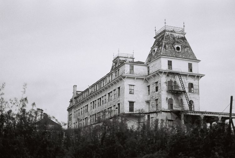 Blast from the past the old abandoned the victorian Wentworth By The Sea hotel 35mm Film Abandoned & Derelict Abandoned Places Alone Death Derelict Gothic Macabre Morbid Victorian Abandoned Abandoned Buildings Architecture Blackandwhite Building Exterior Built Structure Creepy Gothic Style History Hotel Low Angle View No People Sky Towers Wentworth