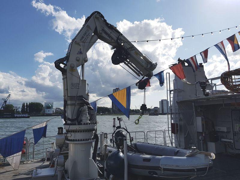 Flag Cloud - Sky No People Outdoors In Front Of Docked Army Marine Life Marine Event Discover Your City Ships Boats Ships⚓️⛵️🚢 War Ship Amazing Warfare Wereldhavendagen Taking Photos Taking Pictures Eye4photography  Nautical Vessel Ship Technology Transportation