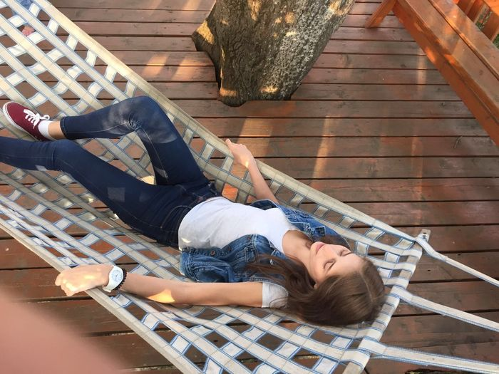 High Angle View Of Woman Relaxing On Hammock