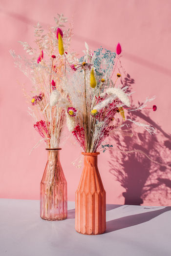 Close-up of pink flowers in vase on table