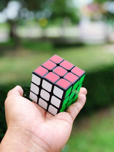 Close-up of person holding puzzle cube
