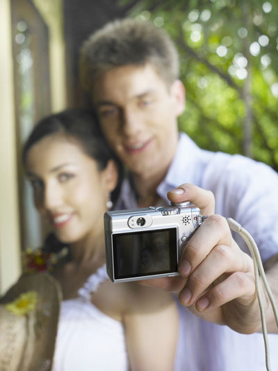couple enjoying honeymoon at resort Content Holiday Romance Vacations Couple - Relationship Enjoying Life Enjoyment Hapiness Happiness Honeymoon Hotel Leisure Activity Lifestyles Looking At Camera Love Luxury Outdoors Photographing Pleasure Portrait Resort Selfie Smiling Togetherness Two People