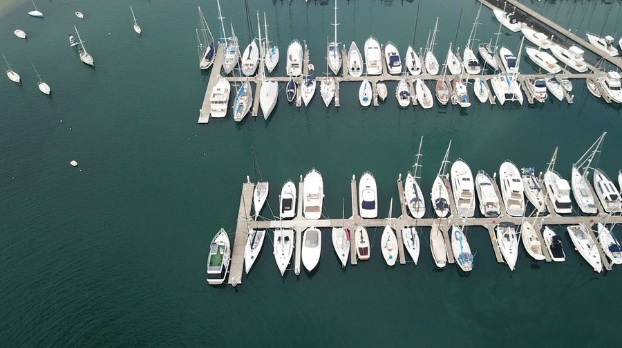 Drone  Sea Nautical Vessel Leisure Activity Relaxation Sailboat Boat Sailing Yacht No People Water Text Architecture Day Built Structure Green Color High Angle View Nature Side By Side Number
