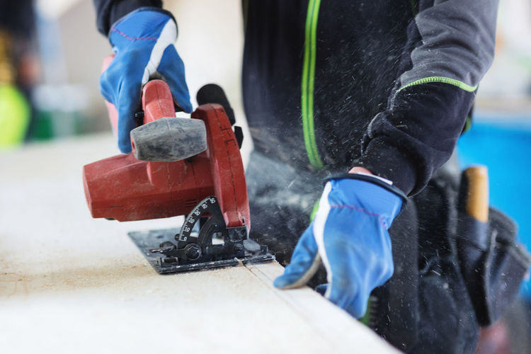 Low section of man working at construction site