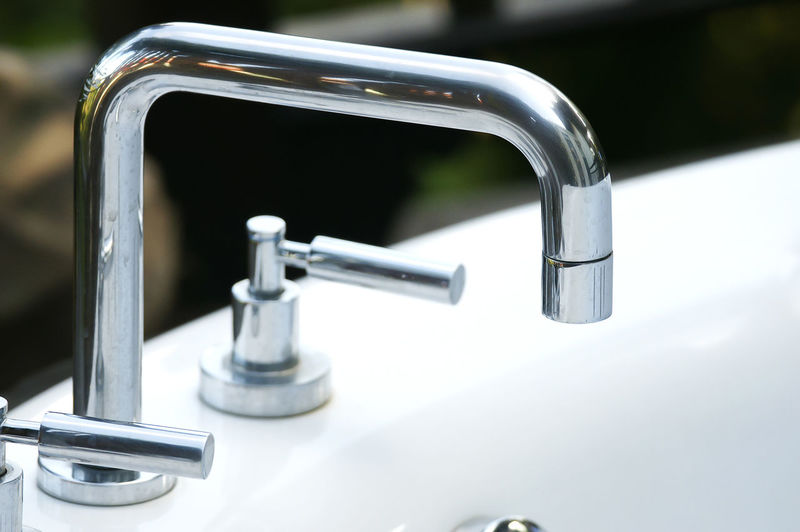 Close-Up Of Faucet At Bathroom Sink