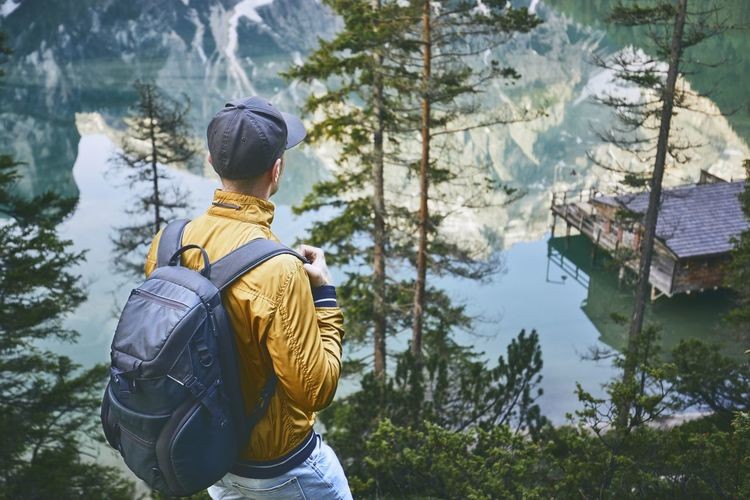 Rear view of hiker wearing cap while looking at view