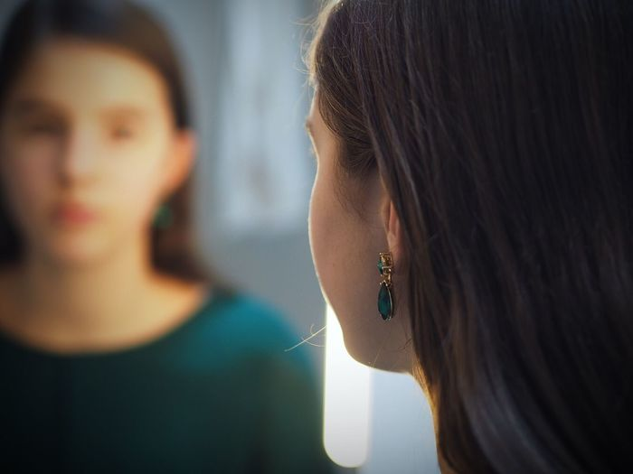 Teenage girl reflecting on mirror