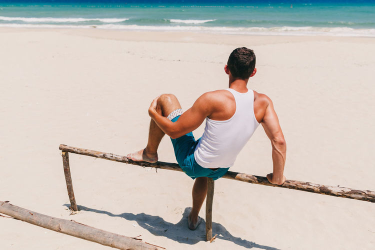man enjoying life and looking at sea on beach. Man sit on beach with sea view. Water Land Nature Sand Beach Ocean Sea Seaview Man Males  Vietnam Relaxing Leisure Activity Lesiure Activity Lifestyles Authentic Moments Enjoying Life Travel Destinations Enjoying The Sun Summer Hot EyeEm Best Shots