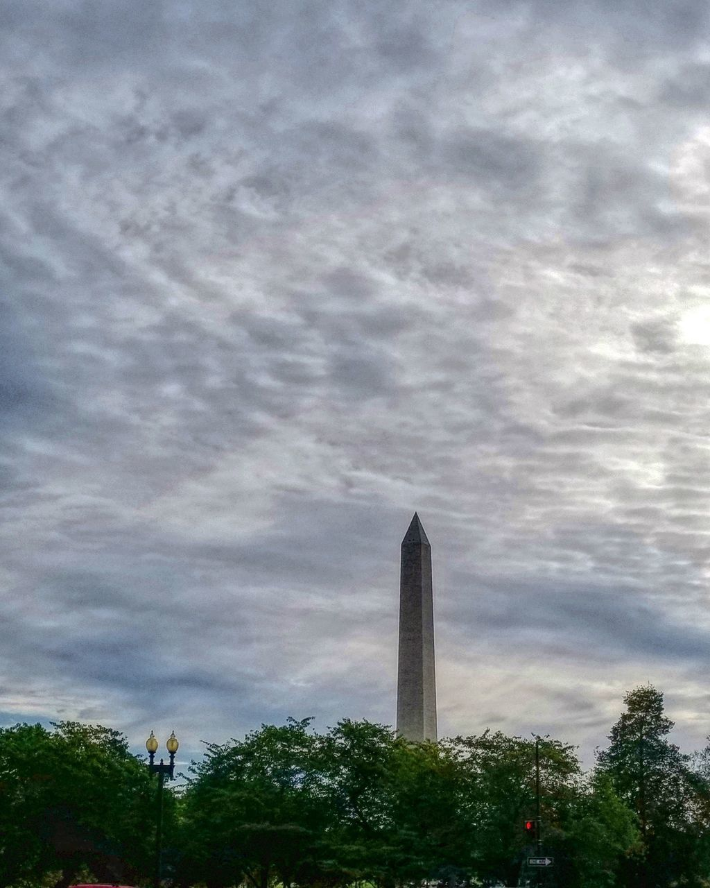 sky, cloud - sky, plant, tree, architecture, built structure, nature, building exterior, low angle view, no people, day, memorial, city, tall - high, outdoors, tower, monument, building, travel destinations, skyscraper, office building exterior, architectural column