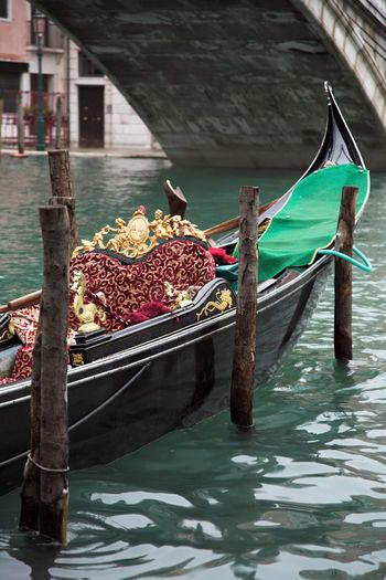 Gondola on the grand canal in venice, italy, close to the rialto bridge
