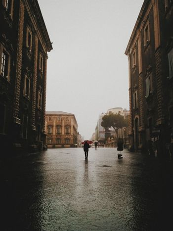 Architecture Building Exterior Built Structure Catania City City Life Full Length Middle Outdoors Rain Rainy Season Road Season  Street Travel Destinations Wet