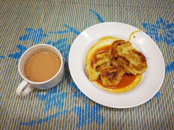 Morning breakfast rotiboom and teh tarik Food And Drink Directly Above No People High Angle View Pattern Textile Healthy Eating Food Plate Ready-to-eat Close-up Indoors  Sweet Food Paratha Roti Canai And Curries Tehtarikmalaysia Creamtea Investing In Quality Of Life PhonePhotography EyeEmNewHere Breathing Space Tikar