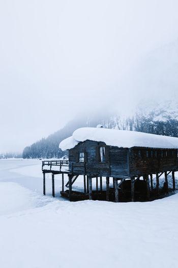 Snow covered house against sky