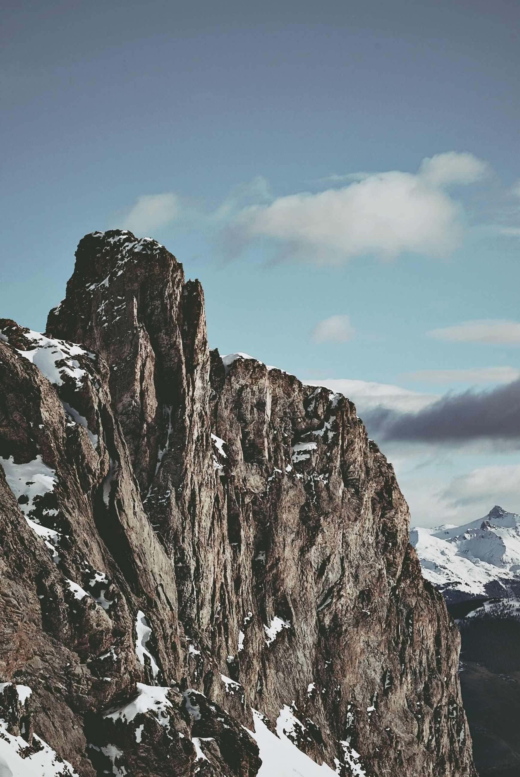 sky, mountain, beauty in nature, scenics - nature, cold temperature, tranquility, cloud - sky, winter, snow, tranquil scene, rock, mountain range, nature, day, non-urban scene, environment, rock - object, no people, solid, formation, mountain peak, outdoors, snowcapped mountain
