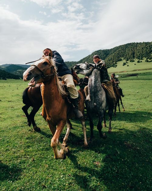During a local performance of the traditional Kyrgyz game Buzkashi, a group of horsemen compete to take control of a dead goat carcass. The horses ram into each other with little care for bystanders who may get in the way. Central Park Horses Kyrgyzstan Nomad EyeEm Olympus The Photojournalist - 2018 EyeEm Awards Action Group Of Animals Kyrgyzgirl Nomakeup Outdoors Running Travel Destinations Week On Eyeem The Traveler - 2018 EyeEm Awards Be Brave A New Perspective On Life
