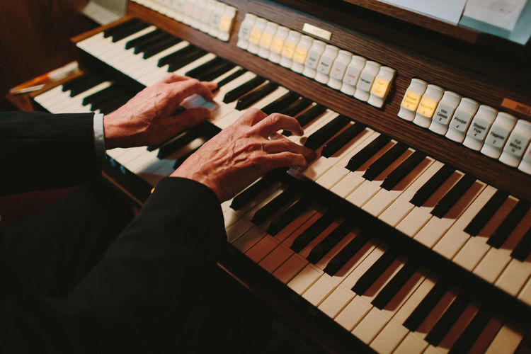 Close-up of man playing organ