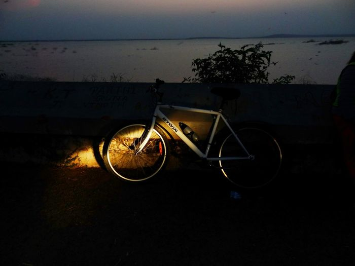 A light to cast for the path at night. Beauty In Nature Light And Shadow Mode Of Transport Nature No People Outdoors Parked Parking Scenics Silhouette Sky Stationary Sunset Sunset_collection Tranquil Scene Tranquility Vignette