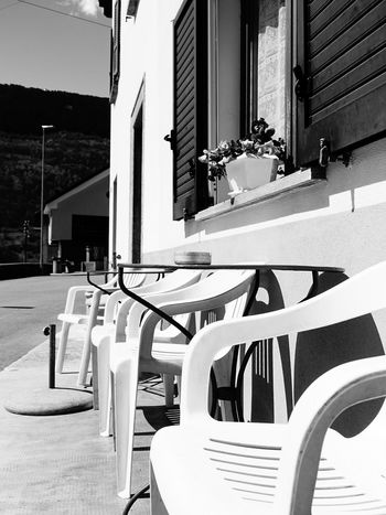 Architecture Black & White Blackandwhite Building Building Exterior Built Structure Dangio High Contrast Landscape Light And Shadow Monochrome Restaurant Swiss Alps Swiss Mountains Switzerland Ticino Valle Di Blenio Flower Chair Table Ashtray  Cloud - Sky Focus On Foreground Selective Focus The Architect - 2016 EyeEm Awards