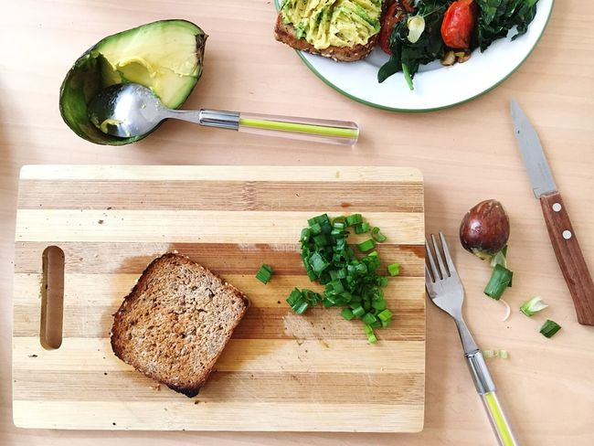 Avocado Kitchen Knife Bread Cutting Board Healthy Eating Table Knife Food And Drink Freshness Food High Angle View Indoors  Table Preparation  Brown Bread Ready-to-eat