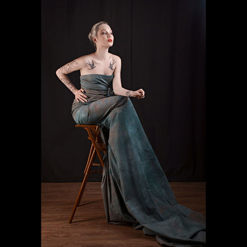Full length of woman sitting on chair
