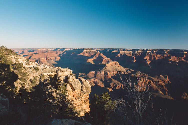 Scenic view of grand canyon national park against clear blue sky during sunset