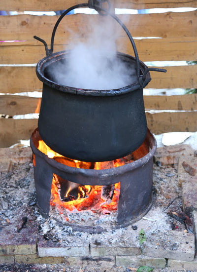 big black pot with the fire lit and the dense white smoke Bonfire Cooking Kettle Magical Smoke Wizard Boiling Bon Fire Burning Camping Stove Cauldron Flame Food And Drink Heat - Temperature Magic Potion No People Open Fire Openfire Preparation  Preparing Food Vin Brule' Vin Brülè Winter