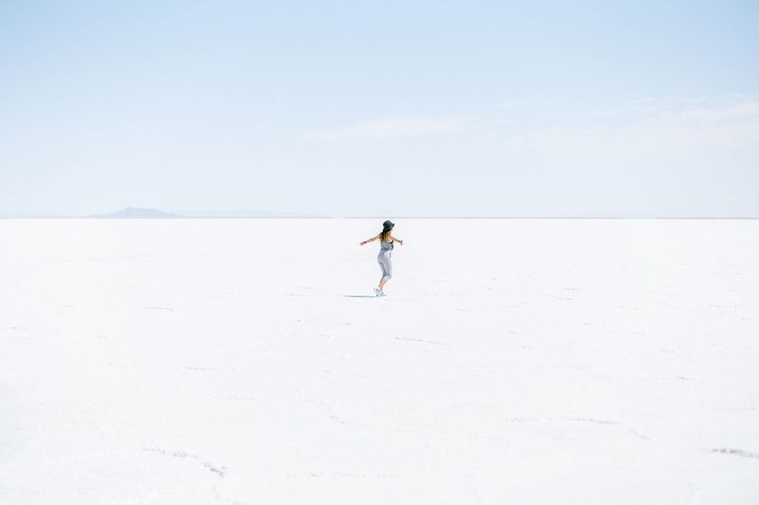 Freedom Spinning Around Excitement Dancing Woman One Person Full Length Land Day Real People Leisure Activity Nature Lifestyles Standing Copy Space Scenics - Nature Non-urban Scene Freedom Remote Outdoors Vacations Solitude Tranquil Scene Sky Salt Flat