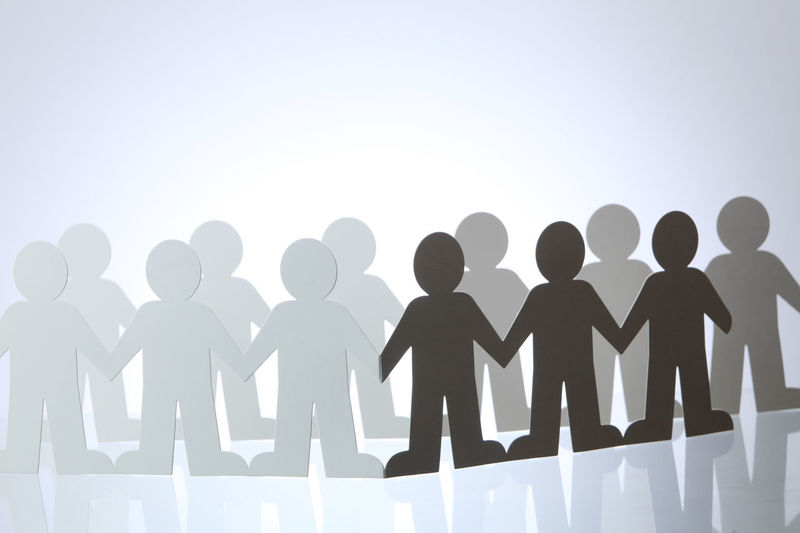 United people paper cut chain as crowd or teamwork abstract concept Business Community Equal Shape Silhouette Social Teamwork Unity Bonding Concept Connection Cooperation Friendship Group Group Of People Holding Linked Network Paper Partnership - Teamwork People Row Symbol Togetherness United