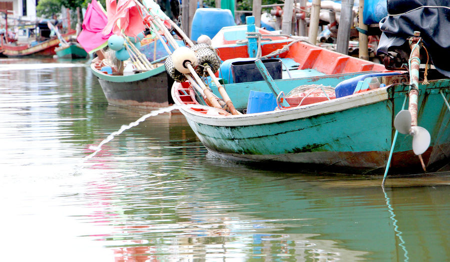 Transportation Water Boat Nautical Vessel Moored Mode Of Transport Reflection Waterfront Group Of Objects In A Row Multi Colored Colorful No People Day Freshness Tranquility Harbor Thailand
