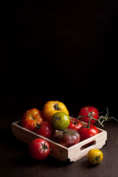 Black Background Choice Copy Space Day Food Food And Drink Freshness Fruit Healthy Eating High Angle View Indoors  Large Group Of Objects No People Red Red Bell Pepper Still Life Studio Shot Table Tomato Variation Vegetable Wood - Material