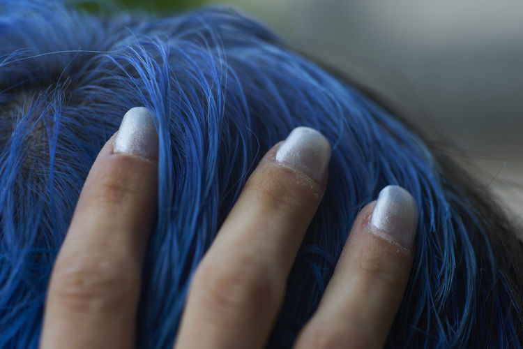 Close-up of hands on blue eyes