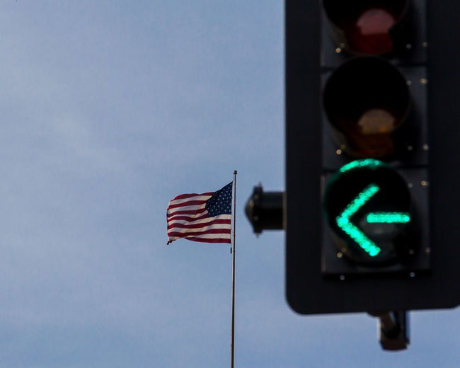 American Flag By Green Light Against Sky