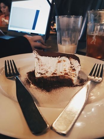 Food And Drink Table Food No People Freshness Cafe Forks Cake Tiramisu Dessert Sweetness Working Getting Work Done Coffee Hongdae Indoors  Plate Chocolate Piece Of Cake a slice of tiramisu on a plate in a cafe